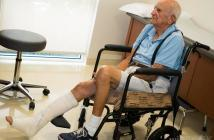 older-man-in-chair-with-broken-leg