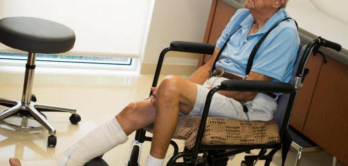 older-man-in-chair-with-broken-leg